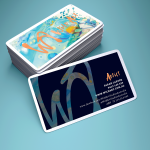 Mockup of business cards designed for WildArt featuring acrylic artwork and gold foil printing