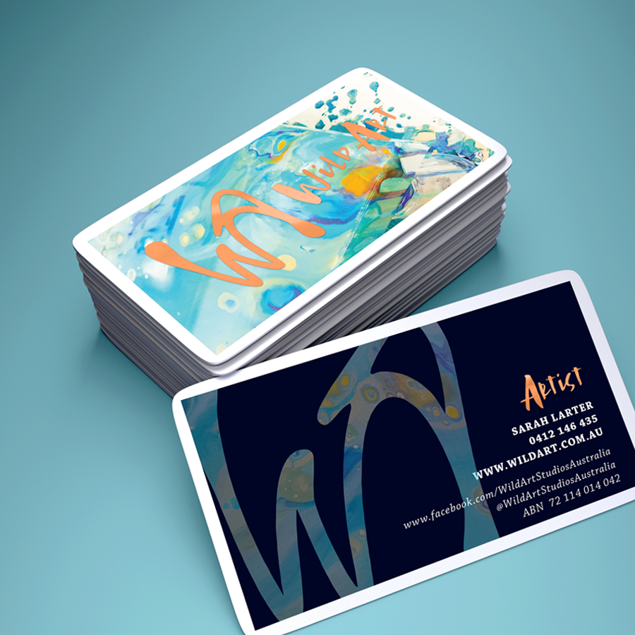 Mockup of business card design for WildArt featuring acrylic artwork and goil foil lettering
